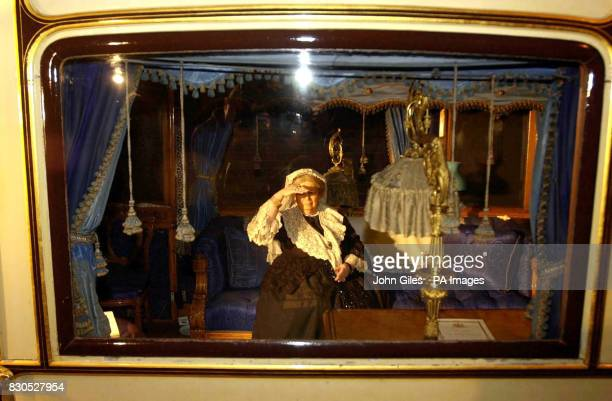 A dummy representing Queen Victoria at the National Railway Museum in York in the interior of the last railway carriage she used before her death A...