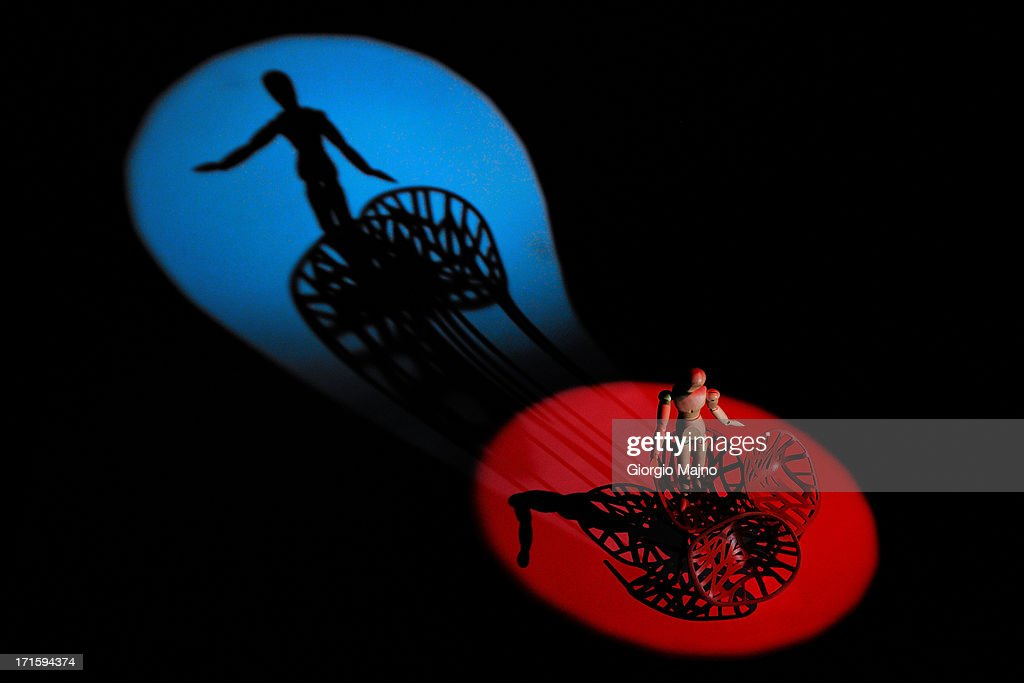 A dummy spot lit on stage and its shadow : Stock Photo