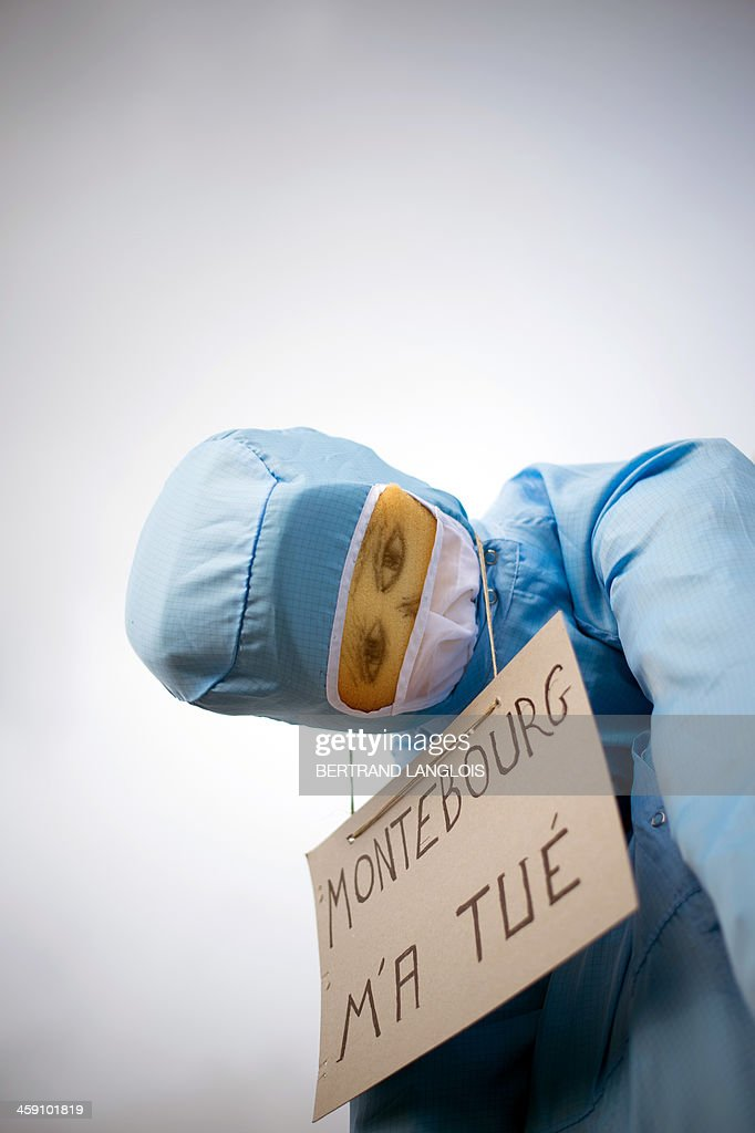 A dummy with a sign reading 'Montebourg killed me' remains hanging from a road sign as workers of semiconductor manufacturer LFoundry block the access to the Industrial Zone in Rousset, near Aix-en-Provence, southern France, on December 23, 2013, after trade unions announced that a court had ordered a judicial liquidation of their factory. Over 670 jobs are at risk if the factory closes and approximately 400 workers took part in the protest and blocade of the Rousset industrial zone, as French Minister for Industrial Renewal Arnaud Montebourg prepared to receive a delegation of workers in Paris today. AFP PHOTO / BERTRAND LANGLOIS