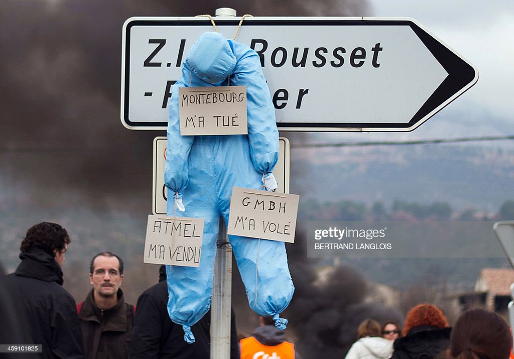 A dummy with signs reading 'Montebourg killed me', 'Atmel sold me', and GMBH stole me' remains hanging from a road sign as workers of semiconductor manufacturer LFoundry block the access to the Industrial Zone in Rousset, near Aix-en-Provence, southern France, on December 23, 2013, after trade unions announced that a court had ordered a judicial liquidation of their factory. Over 670 jobs are at risk if the factory closes and approximately 400 workers took part in the protest and blocade of the Rousset industrial zone, as French Minister for Industrial Renewal Arnaud Montebourg prepared to receive a delegation of workers in Paris today.