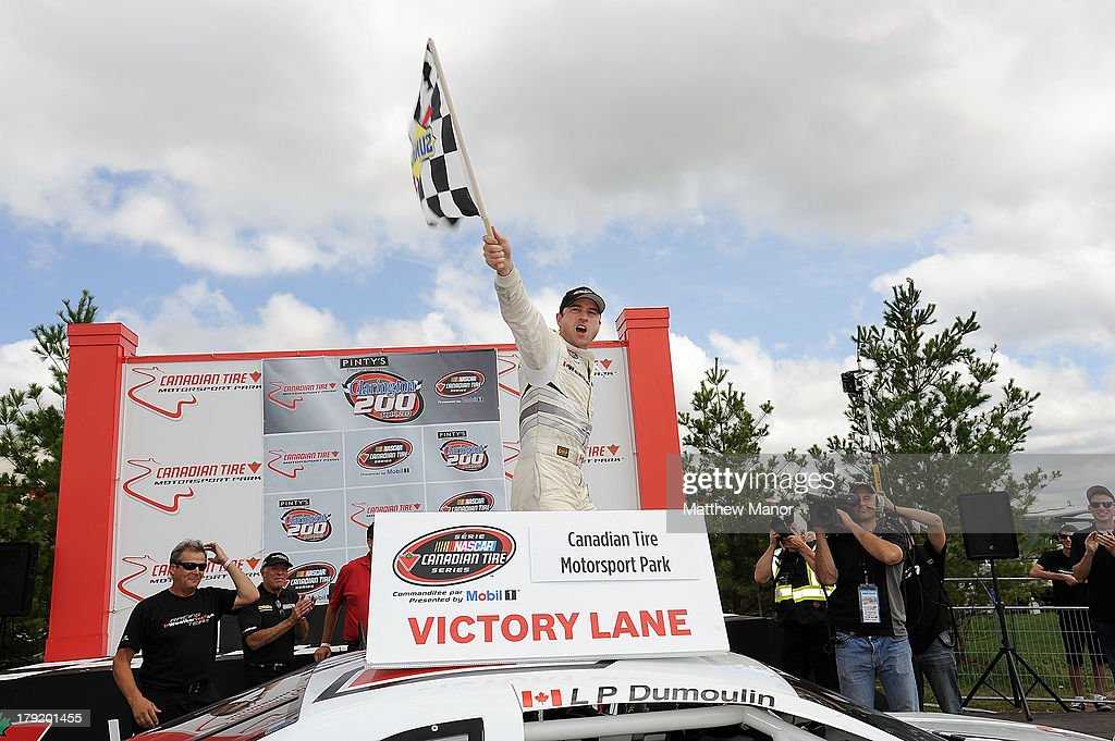 L.P. Dumoulin, driver of the #47 WeatherTech Canada/Bellemare Dodge celebrates his win at the NASCAR Canadian Tire Series presented by Mobil 1 Pinty's presents the Clarington 200 at Canadian Tire Motorsport Park on September 1, 2013 in Bowmanville, Canada.