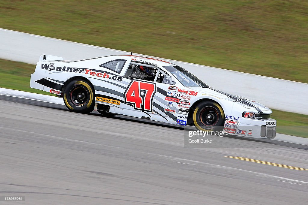 L.P. Dumoulin, driver of the #47 Weathertech Canada/Bellemare Dodge, practices for the NASCAR Canadian Tire Series presented by Mobil 1 Pinty's presents the Clarington 200 at Canadian Tire Motorsport Park on August 31, 2013 in Bowmanville, Canada.