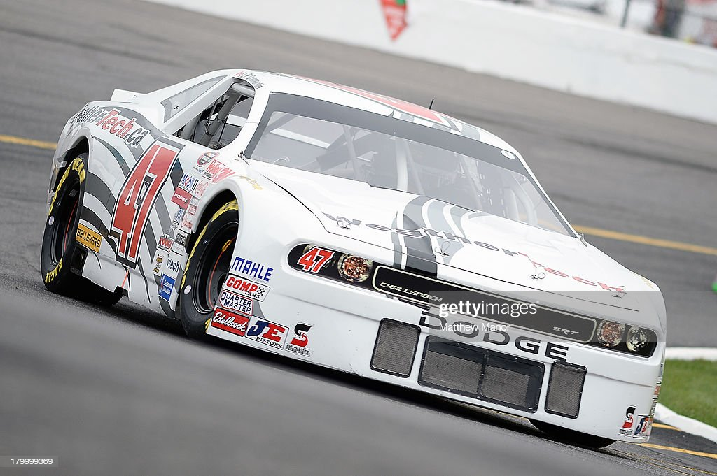 LP Dumoulin, driver of the #47 WeatherTech Canada/Bellemare, turns some laps during practice prior to the NASCAR Canadian Tire Series race at Barrie Speedway on September 7, 2013 in Oro Station, Ontario, Canada.