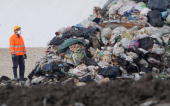 A dump employee looks at rubbish from the Naples area on June 16 2008 in Savignano Irpino The site at Savignano Irpino some 100 kilometres northeast...