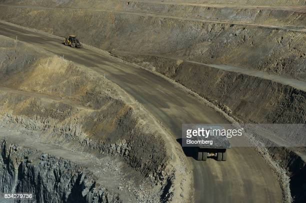 A dump truck bottom drives along an access ramp in the White Foil open mine pit at Evolution Mining Ltd's gold operations in Mungari Australia on...