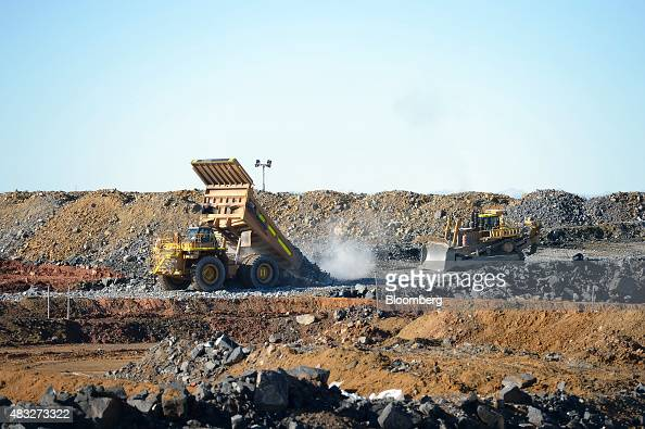 A dump truck deposits a load of ore at the runofmine pad at Evolution Mining Ltd's gold operations in Mungari Australia on Wednesday Aug 5 2015 A...