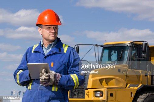 Dump Truck Driver and Tablet Cmoputer