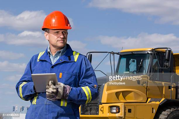Dump Truck Driver and Tablet Computer