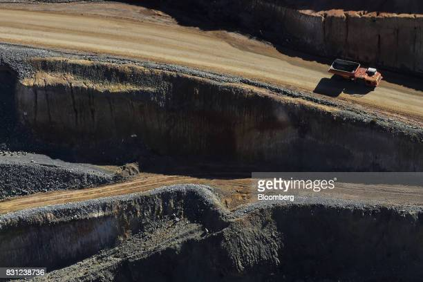 A dump truck drives along a haul road in an open pit mine at Northern Star Resources Ltd's Kalgoorlie Operations in this aerial photograph taken near...