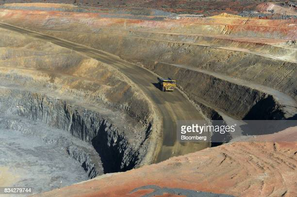 A dump truck drives along an access ramp in the White Foil open mine pit at Evolution Mining Ltd's gold operations in Mungari Australia on Tuesday...