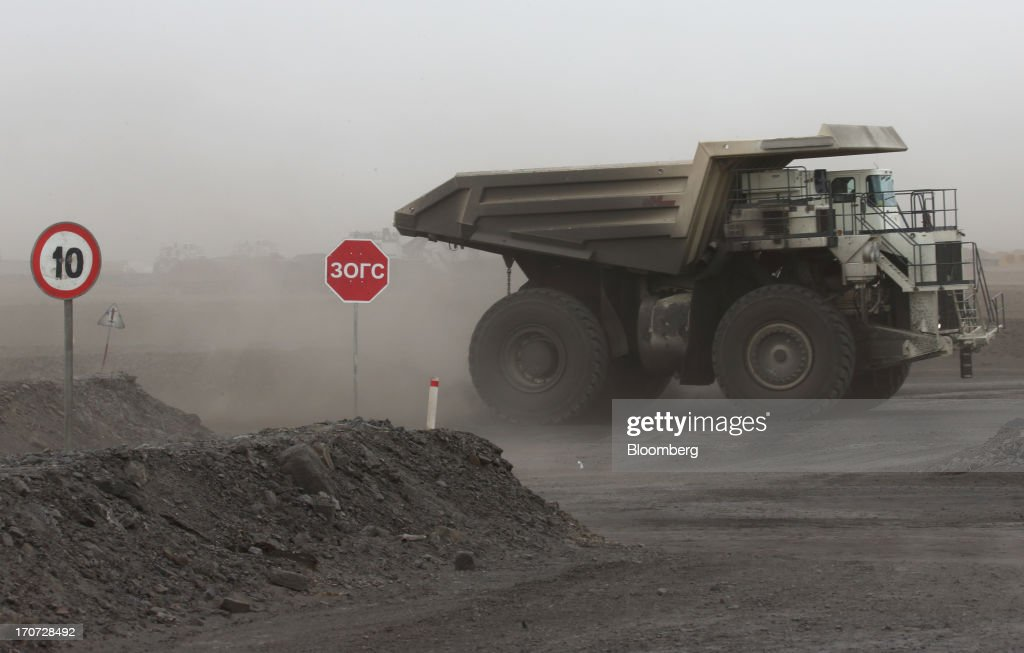 A dump truck drives at the open pit in the Tsankhi section of the Tavan Tolgoi coal deposit, developed by Erdenes Tavan Tolgoi LLC, in South Gobi, Mongolia, on Wednesday, June 5, 2013. Mongolia, a country of almost 2.9 million people, has some of the world's biggest undeveloped mineral reserves, including Oyu Tolgoi, a copper and gold mine, and Tavan Tolgoi, a coal deposit. Photographer: Tomohiro Ohsumi/Bloomberg via Getty Images