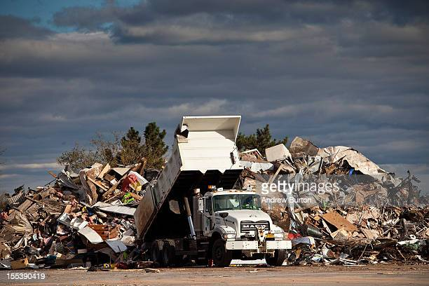 A dump truck empties trash collected from Superstorm Sandy damaged homes on November 3 2012 in the Midland Beach neighborhood of Staten Island...