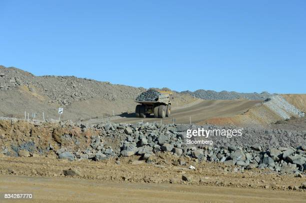A dump truck filled with ore drives out of the White Foil open mine pit at Evolution Mining Ltd's gold operations in Mungari Australia on Tuesday Aug...
