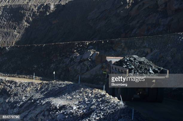 A dump truck laden with ore drives out of the White Foil open mine pit at Evolution Mining Ltd's gold operations in Mungari Australia on Tuesday Aug...