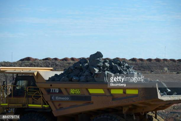 A dump truck laden with ore sits in the White Foil open mine pit at Evolution Mining Ltd's gold operations in Mungari Australia on Tuesday Aug 8 2017...