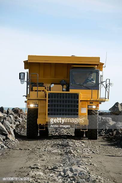 Dump truck on dirt track