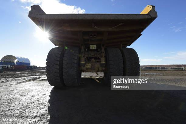 A dump truck sits parked in a workshop area of the St Ives Gold Mine operated by Gold Fields Ltd in Kambalda Australia on Wednesday Aug 9 2017 Global...