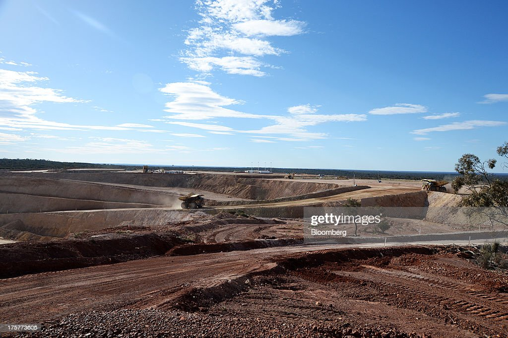 A dump truck transports ore at the Norton Gold Fields Ltd. Enterprise operations 68 kilometers north-west of Kalgoorlie, Australia, on Wednesday, Aug. 7, 2013. Norton, the Australian producer controlled by China's Zijin Mining Group Co., is seeking further acquisition targets as falling prices cut the value of mines. Photographer: Carla Gottgens/Bloomberg via Getty Images