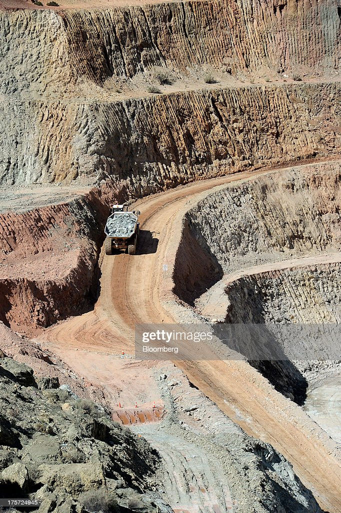 A dump truck transports ore from the mine pit at the Phoenix Gold Ltd. Castle Hill gold project in Kunanalling, northwest of Kalgoorlie, Australia, on Tuesday, Aug. 6, 2013. Gold prices will rebound as output remains little changed or declines this year with producers cutting spending and shuttering some costly operations, the World Gold Council said. Photographer: Carla Gottgens/Bloomberg via Getty Images