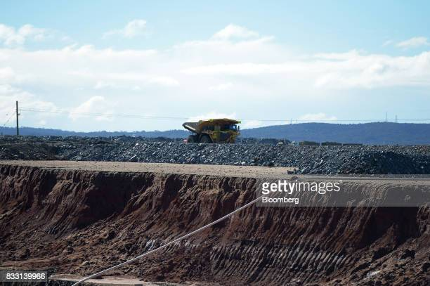A dump truck travels along a track at the St Ives Gold Mine operated by Gold Fields Ltd in Kambalda Australia on Wednesday Aug 9 2017 Global gold...