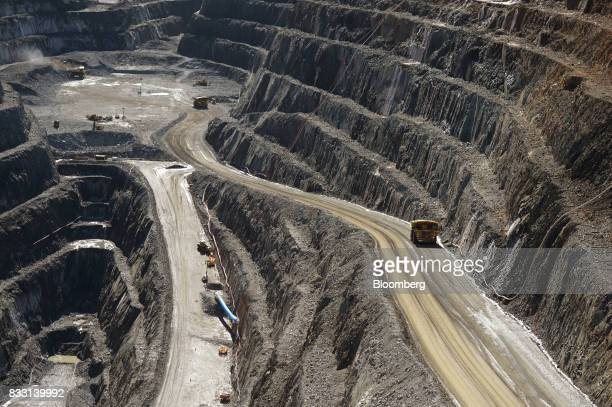 A dump truck travels along an access ramp of the Invincible mine at the St Ives Gold Mine operated by Gold Fields Ltd in Kambalda Australia on...