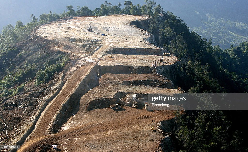 Dump trucks and excavators operate in this aerial view of the G-Resources Group Ltd. Martabe gold and silver mine in Batang Toru, North Sumatra province, Indonesia, on Wednesday, Feb. 13, 2013. G-Resources is scheduled to announce financial results on Feb. 28. Photographer: Dadang Tri/Bloomberg via Getty Images
