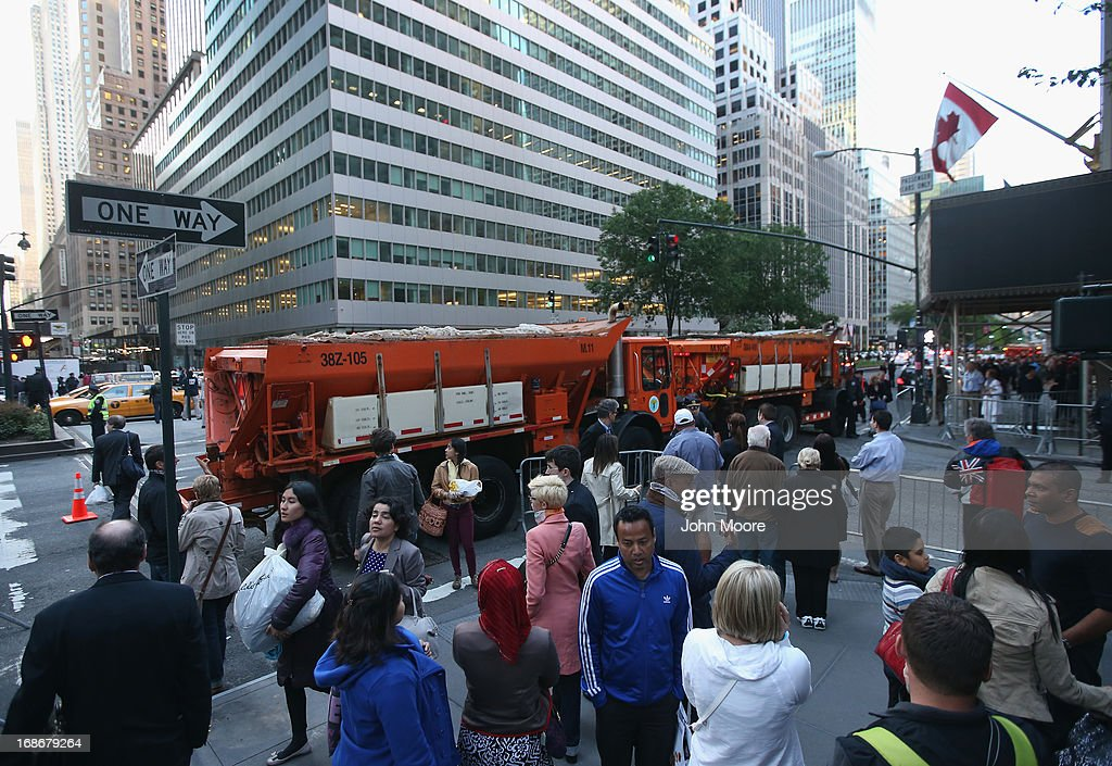 Dump trucks block the entry to the Waldorf-Astoria Hotel outside a fundraising event by U.S. President Barack Obama on May 13, 2013 in New York City. Hundreds of demonstrators marched outside the event to protest the building of oil pipelines and calling for the end of hydraulic fracking for oil and gas.