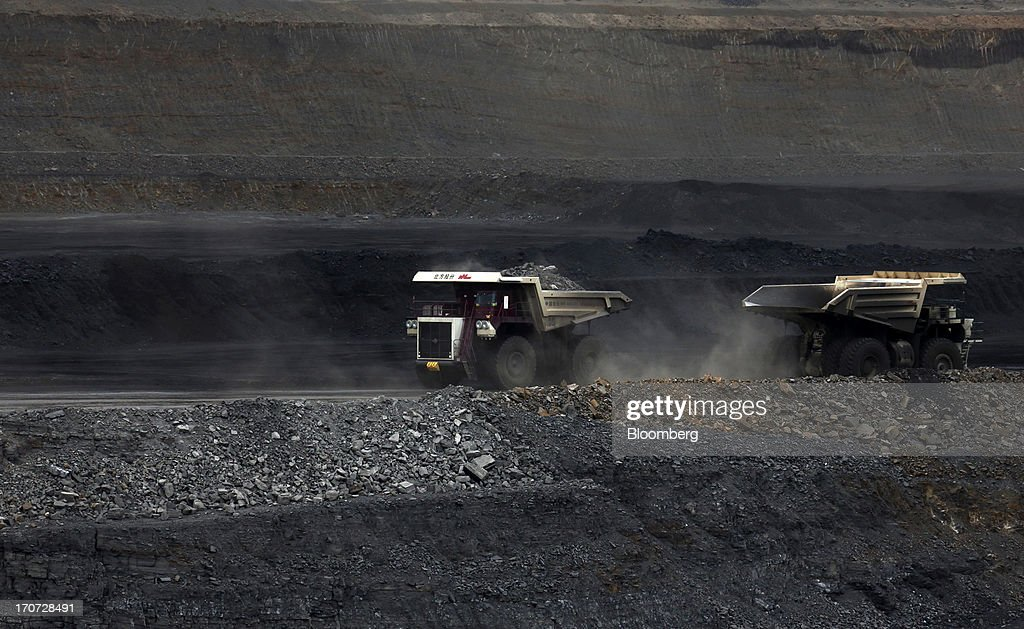 Dump trucks carry coal at the open pit in the Tsankhi section of the Tavan Tolgoi coal deposit, developed by Erdenes Tavan Tolgoi LLC, in South Gobi, Mongolia, on Wednesday, June 5, 2013. Mongolia, a country of almost 2.9 million people, has some of the world's biggest undeveloped mineral reserves, including Oyu Tolgoi, a copper and gold mine, and Tavan Tolgoi, a coal deposit. Photographer: Tomohiro Ohsumi/Bloomberg via Getty Images