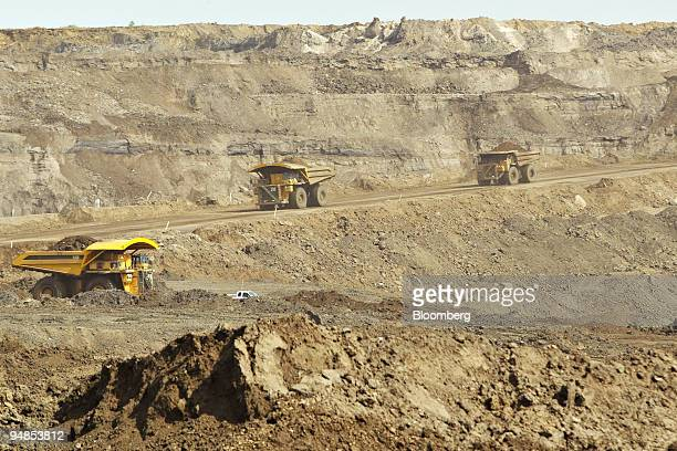 Dump Trucks carry oil sands along a road in the Suncor Energy Millennium mine in Ft McMurray Alberta Canada Friday July 8 2005