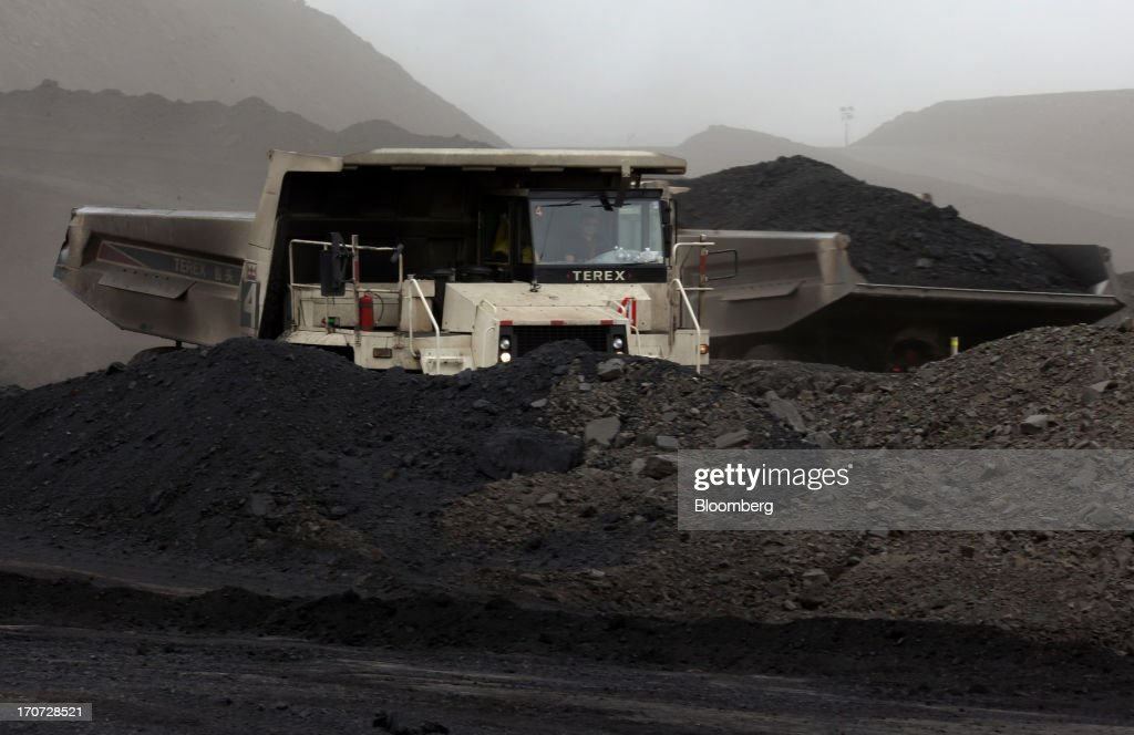 Dump trucks drive at the open pit in the Tsankhi section of the Tavan Tolgoi coal deposit, developed by Erdenes Tavan Tolgoi LLC, in South Gobi, Mongolia, on Wednesday, June 5, 2013. Mongolia, a country of almost 2.9 million people, has some of the world's biggest undeveloped mineral reserves, including Oyu Tolgoi, a copper and gold mine, and Tavan Tolgoi, a coal deposit. Photographer: Tomohiro Ohsumi/Bloomberg via Getty Images