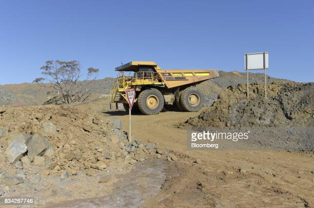 A dump trucks drives down an access ramp at Evolution Mining Ltd's gold operations in Mungari Australia on Tuesday Aug 8 2017 Evolution Mining is...