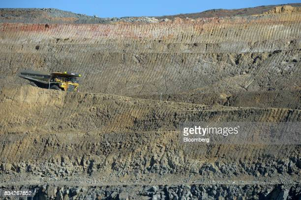 A dump trucks drives down an access ramp to the White Foil open mine pit at Evolution Mining Ltd's gold operations in Mungari Australia on Tuesday...