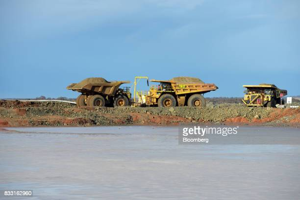 Dump trucks sit beyond a salt lake at the St Ives Gold Mine operated by Gold Fields Ltd in Kambalda Australia on Wednesday Aug 9 2017 Global gold...