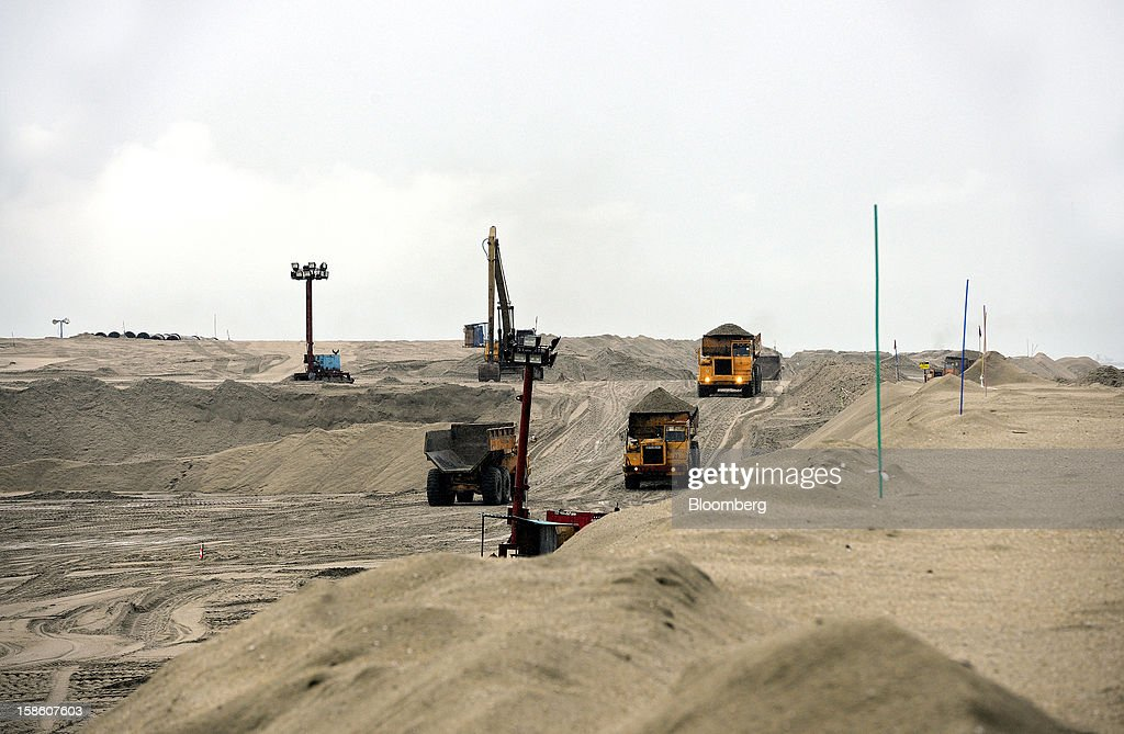 Dump trucks transport sand used for land reclamation at the construction site of Dialog Group Bhd.'s new storage terminal in Pengerang, Johor, Malaysia, on Tuesday, Dec. 18, 2012. Dialog, Malaysia's second-biggest oil and gas services provider, said it signed some customers for the 1.9 billion-ringgit ($620 million) storage terminal it's developing with Royal Vopak NV. Photographer: Munshi Ahmed/Bloomberg via Getty Images