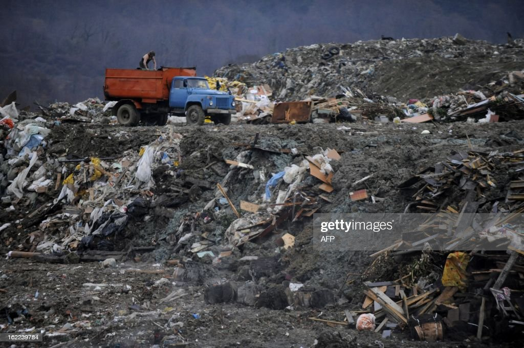 Dump trucks unload garbage at a dumping ground near the village of Gorny Vozdukh (Mountain Air) some 14 km outside of the Russian Black Sea resort of Sochi on February 21, 2013.