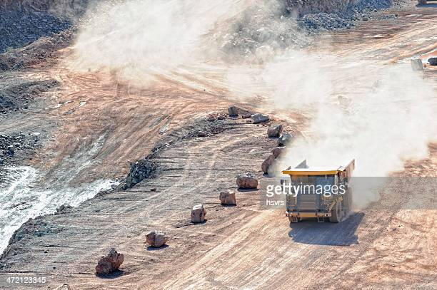 dumper truck on road in surface mine quarry