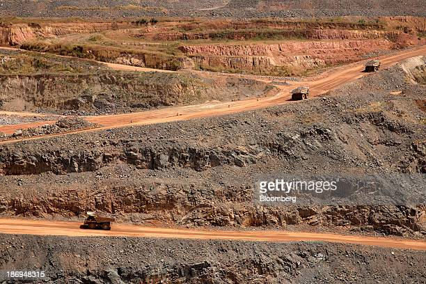 Dumper trucks collect rock ore from from the pit floor in the open air gold mine operated by Randgold Resources Ltd in Gounkoto Mali on Friday Nov 1...