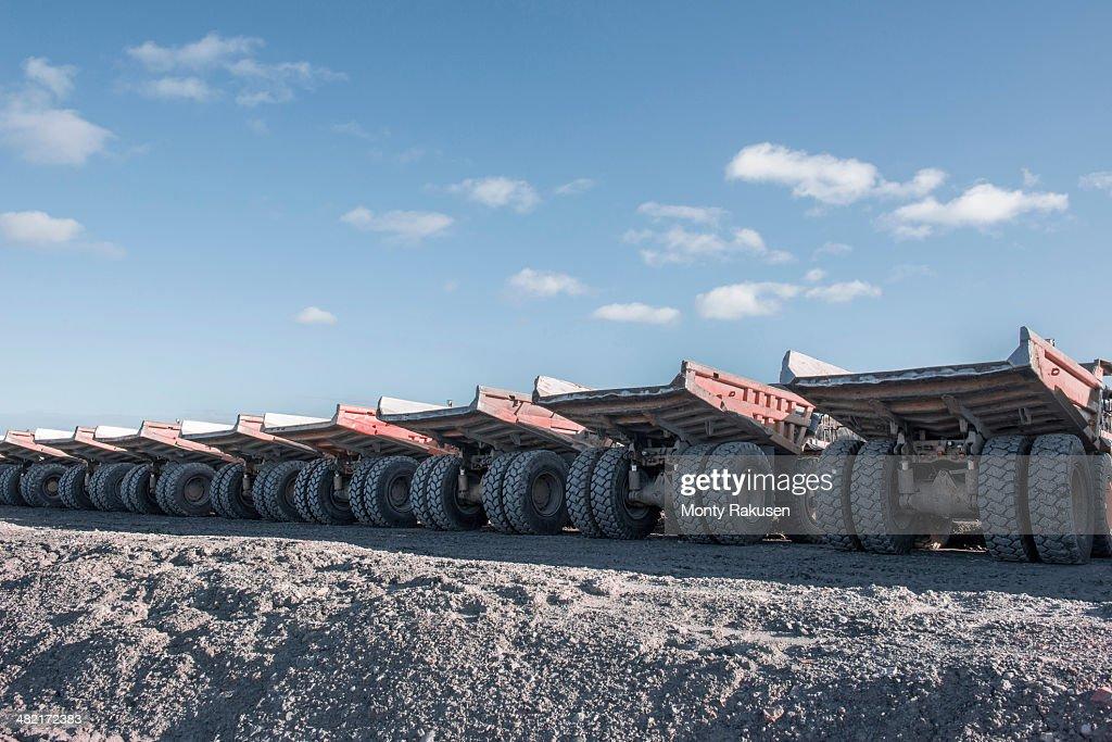 Dumper trucks in a row at surface coal mine
