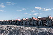 Dumper trucks in a row at surface coal mine