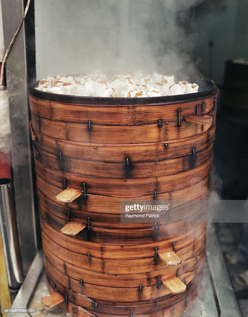 Dumplings being steamed : Stock Photo