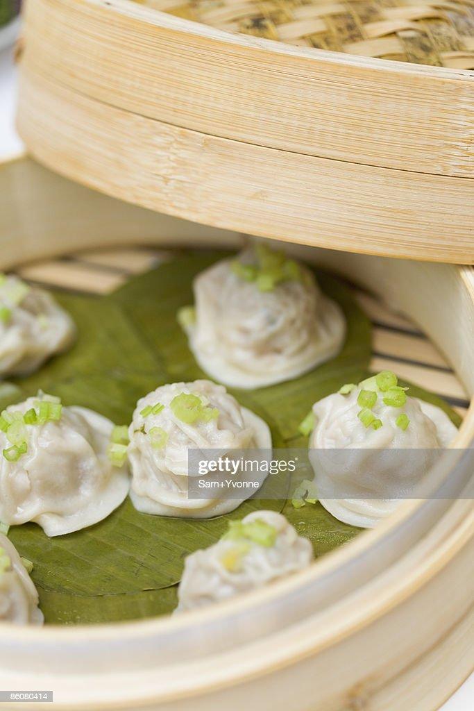 Dumplings in bamboo steamer : Stock Photo