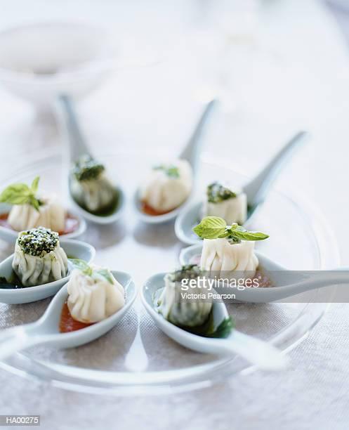 Dumplings on soup spoons