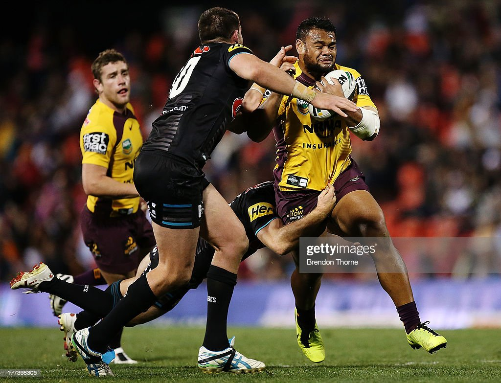 Dunamis Lui of the Broncos is tackled by the Panthers defence during the round 24 NRL match between the Penrith Panthers and the Brisbane Broncos at Centrebet Stadium on August 23, 2013 in Sydney, Australia.