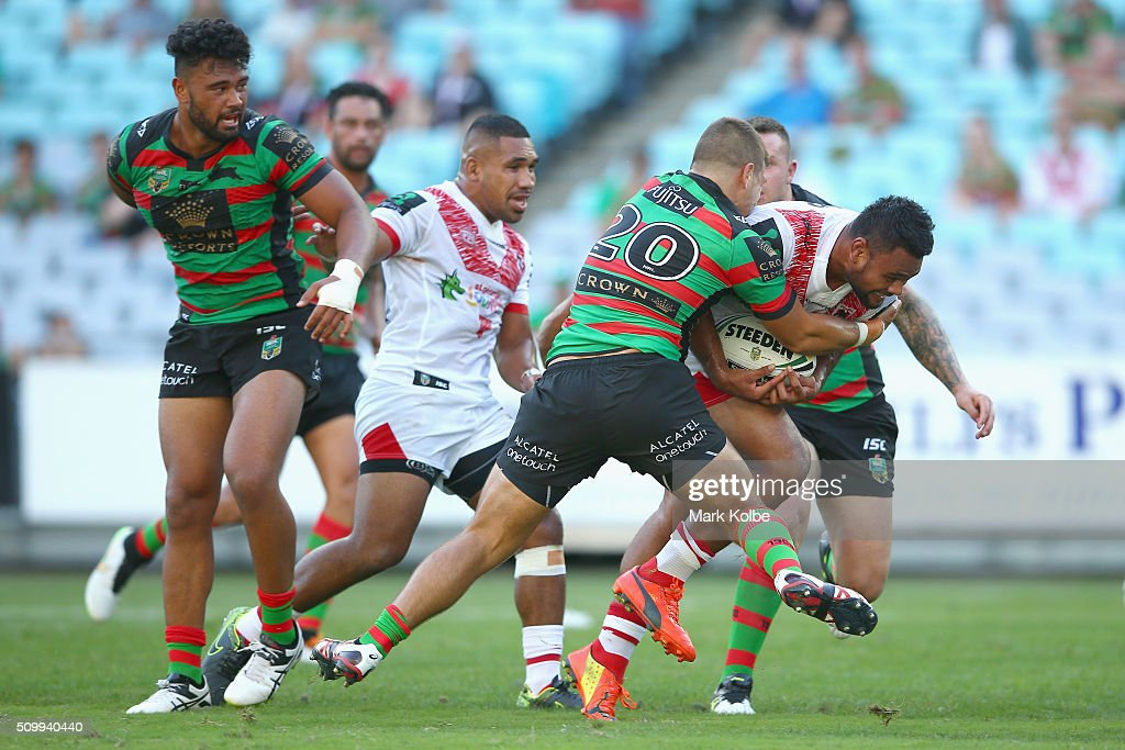 Dunamis Lui of the Dragons is tackled during the NRL Charity Shield match between the St George Illawarra Dragons and the South Sydney Rabbitohs at ANZ Stadium on February 13, 2016 in Sydney, Australia.
