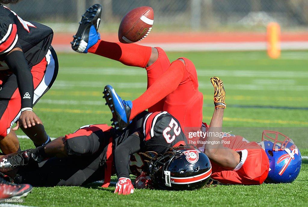 Dunbar's Devon Fuller breaks up a pass to Anacostia's Tyray Johnson as Dunbar defeats Anacostia 12 - 8 in the Turkey Bowl at Eastern High School in Washington DC, November 22, 2012 .