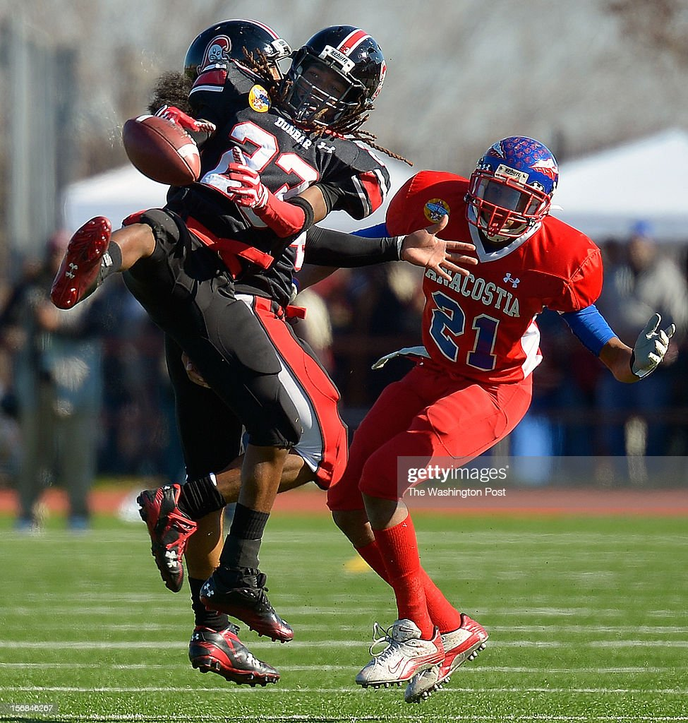 Dunbar's Devon Fuller, left, breaks up a 2nd quarter pass intended for Anacostia's Marcus Daniels as Dunbar defeats Anacostia 12 - 8 in the Turkey Bowl at Eastern High School in Washington DC, November 22, 2012 .
