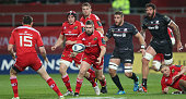 Duncan Casey of Munster passes the ball during the European Rugby Champions Cup match between Munster and Saracens at Thomond Park on October 24 2014...