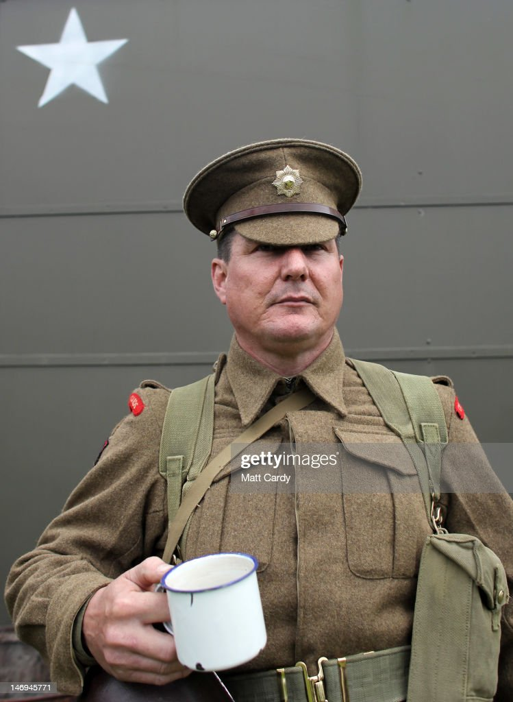 Duncan Edwards dresses as a Second World War Coldstream Guard as part of the two-day Maiden Newton At War 1940s re-enactment weekend in Maiden Newton on June 23, 2012 near Dorchester, England. The quiet Dorset village of Newton Maiden was seen as a strategic hub during the Second World War and was heavily fortified against a threatened German invasion. It later saw hundreds of American servicemen quartered in the area before the D Day landings. To celebrate the village's wartime past, the biennial event, which started in 2008, has grown into one of the biggest re-enactments in the country and this year featured one of the largest convoys of Second World War vehicles seen in Dorset since D Day in 1944.