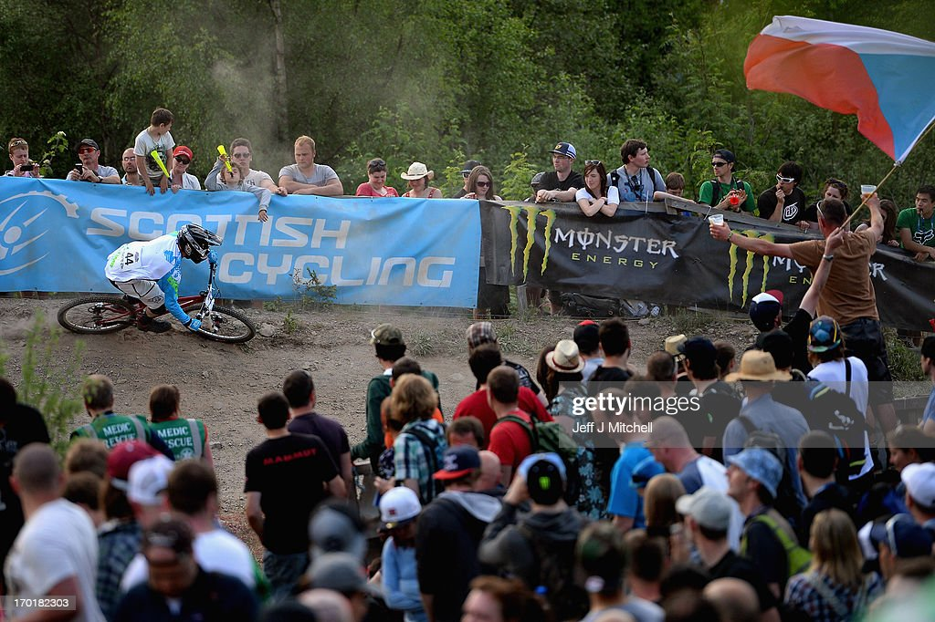 Duncan Ferris competes in the men's four cross pro tour qualification at the UCI Mountain Bike World Cup on June 8, 2013 in Fort William, Scotland.