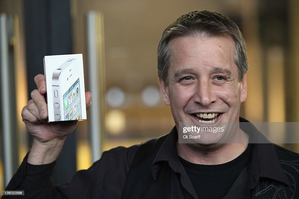 Duncan Hoare, the first person to leave the Apple store in Covent Garden after buying an iPhone 4S on October 14, 2011 in London, England. The widely anticipated new mobile phone from Apple has seen customers queue in cities around the world for hours to be amongst the first to buy the device.
